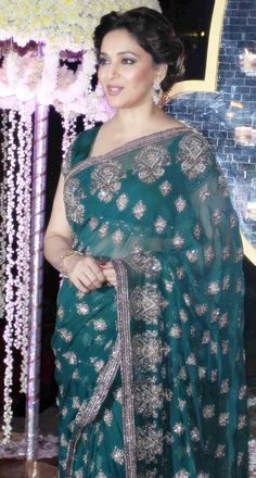 Ageless beauty Madhuri dixit in Manish malhotra green embroidery sareewith matching blouse at Riddhi malhotra-Tejas wedding reception party in Mumbai.