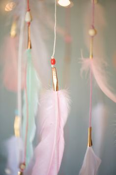 I have one of these ready to ship!!! This is very rare, so if you need it quickly take advantage!  Please visit my website, DREAMKEEPERS.CO for a larger and ready to ship selection!  This is so soft and subtle, with its coral, pink, mint and white feathers. It features matching string, coordinated beads and some gold, silver and copper accents.  It has a willow ring that is 7-9 in diameter.  Photos by Dreamkeepers  *Please keep out of the reach of children and exercise caution when placing…