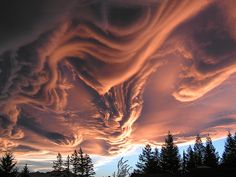I can't tell how real this is -- clouds can do crazy-amazing things -- but this gives me chills (in a good way).