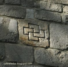 The mysterious pagan swastika on the outer wall of the collegiate church in Kruszwica.