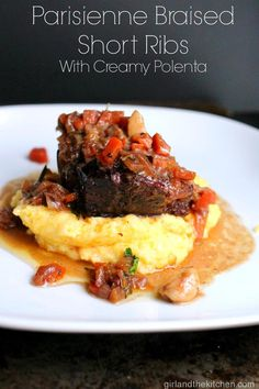 Parisian Braised Short Ribs are a tender, melt in your mouth super flavorful and simple short rip recipe all on top of a creamy polenta. girlandthkitchen.com