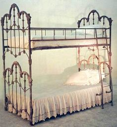 """Victorian Bunk Beds  The only ones we have seen...ideally suited for pretty princess bedrooms, for sisters and sleepovers. Iron posts with Argentina rust finish.  Accomodates standard twin matresses. 76 x 41 x 86"""""""