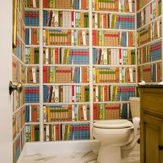 Guest toilet room. Half way with books or full on. Pale floor with bright white fixtures. Funny!