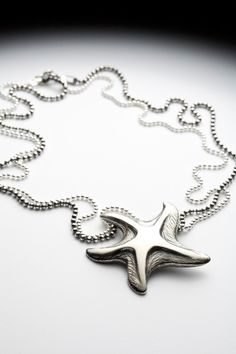 Sterling silver starfish necklace - Remember Summer - Red Sofa jewelry. $145.00, via Etsy.