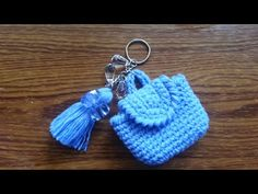How to make the Mini-Bag Charms. ORIGINAL DESIGN This video shows how to make a mini-bag keychain that is worked in oval. This is an original pattern. I also made another version and you may click the link below: . Crochet Keychain, Crochet Earrings, Diy Crochet, Crochet Baby, Crochet Stitches, Crochet Patterns, Mochila Crochet, Mini Mochila, Crochet Purses