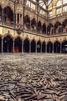 A beautiful stock exchange which has been left abandoned for many years, with the messy parquet floor serving as a beautiful contrast to the ornate architecture.  At the heart of Gina Soden's pho...