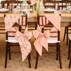 I've always hated the idea of putting the white chair cover and tying a ribbon on it for color but this is a modern way of doing it that I think I like.