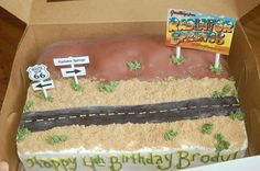 "Cars cake... desert road w/ Radiator Springs billboard.  Could add another billboard w/ ""Happy Birthday..."" on it."