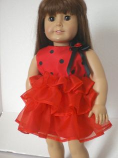 Jenny is wearing a sleeveless ruffled red dress with black polko-dots.  She looks life-like.