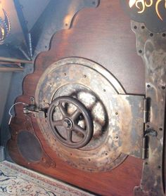 Mock submarine door that could cover a crawl space in a child's room