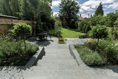 Family Garden, upper and lower stone terrance, wrapped with lawn, hidden trampoline Garden Design London, Garden Site, Family Garden, Garden Plants, Stepping Stones, Lawn, Living Spaces, Sidewalk, Green