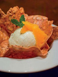 The new Wolfgang Puck Pizzeria & Cucina at the MGM Grand Detroit. Tangerine Granita, Vanilla Ice Cream, Almond Tuile.