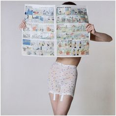 Model, reading the comic section of the paper, and wearing confetti print girdle Vogue february – 1963.  It should read...Why are skinny women wearing girdles?  Photo by Louis Faurer