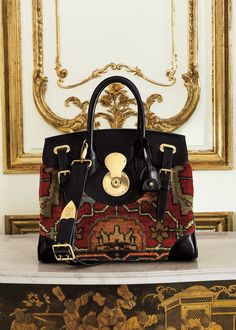 Crafted from swatches of authentic vintage carpets, this season's boldest bag has heirloom-inspired style