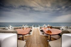 """Front deck dining area onboard the incredible private superyacht """"Zenith"""". Designed by ID Studios Pyrmont"""