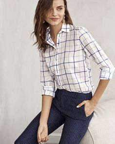 Our classic button down gets a chic summer inspired Dillon fit shirt with windowpane detailing. Pair this blue and white top with our Avery fit pants and heels for the perfect office ready look | Banana Republic