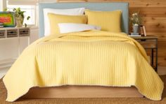 This quilt set by Ivy Hill features an 88'' x 92'' Full/Queen quilt and two 20'' x 26'' pillow shams in a solid yellow print. Cotton and polyester fabrication makes this quilt soft and comfortable for any bedroom setting.