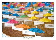For place cards: cute umbrellas.  Beach theme but more casual.