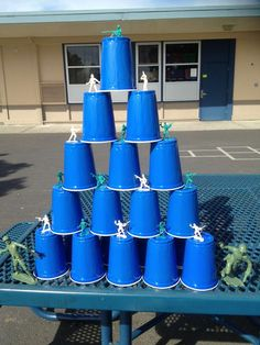Solo cups and little toy soldiers stacked for Nerf gun target game