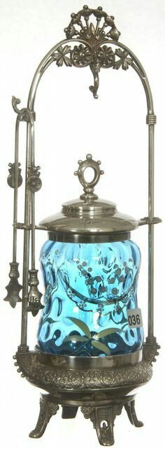 BLUE ART GLASS COIN SPOT CORSET SHAPED INSERT - SET ON FANCY SILVER PLATE FRAME - ENAMEL LILY OF THE VALLEY DECOR - LID SLIDES UP FRAME AND HOOKS ON TOP HOOK -