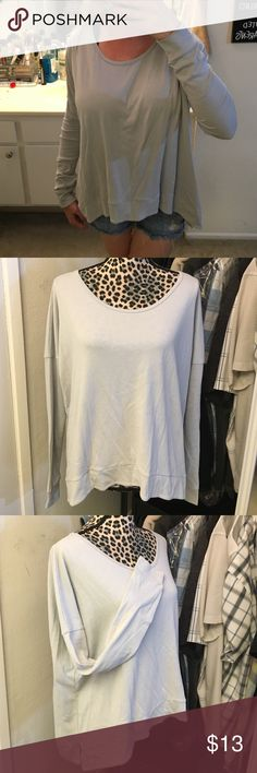 Like new shirt by Hollister Super cute like new worn once light grey hi low shirt by Hollister size extra small / small Hollister Tops Tees - Long Sleeve