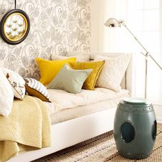 Unlikely Pairs  Gray and yellow are an unexpected color combination that works beautifully. The gray paisley wallpaper creates an accent wall that is fun yet neutral. The yellow throw and accent pillows on the daybed pop against the patterned wall. Hints of blue bring out the gray's blue undertones.