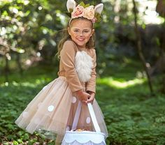 Adorned with whimsical woodland accents like flowers, tulle and luxe faux-fur, this enchanting deer costume is bound to be a pretend play favorite for years to come. Girl Deer Costume, Baby Deer Costume, Deer Costume For Kids, Bambi Costume, Deer Halloween Costumes, Fairy Costume Kids, Dear Costume, Gnome Costume, Reindeer Costume