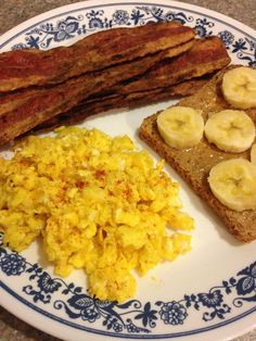 21 Day Fix Breakfast - 2 large scrambled eggs seasoned with all purpose seasoning, 4 slices of turkey bacon, 1 slice of Ezekiel bread with 1 teaspoon of natural peanut butter, half a banana (2 red, 1 yellow, 1 teaspoon, 1 purple)