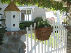 a REPURPUSED bicycle basket! how cute is this?!?!!!!! ♥ White Ironstone Cottage