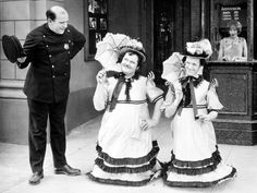 Laurel & Hardy elude Edgar Kennedy in a scene cut from THEIR PURPLE MOMENT (1928).