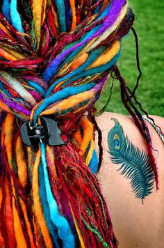 Dude! Now thems some crazy cool dreadlocks and tat!