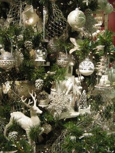 Close-up of an Ivory-Platinum themed tree at the Bethany Lowe Designs showroom in Atlanta. Tree is embellished with glittered pinecone ornaments, large glittered deer sculptures, vintage inspired globe ornaments and more! http://bethanylowe.com/