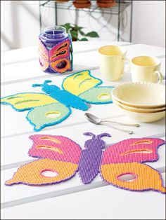 Fanciful Butterflies Plastic Canvas Pattern Download from e-PatternsCentral.com -- Enjoy the beauty of nature with fanciful butterfly place mats and a matching candle wrap.