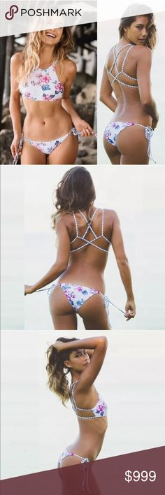 • Pacific Beach • Strappy Floral Halter Bikini Just in! Strappy Floral Halter Bikini - White with pink + blue floral print • Halter top with strappy back • Reversible print with white + blue stripes • Side tie bottoms • Sporty + Sexy! • Actual pics of the item in Size Large posted. Not Acacia or Frankie. Unbranded & new from maker ⭐️5 Star Rated ⭐️ Swim Bikinis