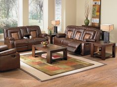 Dual Purpose. The Mustang reclining loveseat with console provides both convenience and comfort in a distinct modern style. With its brown two-toned leather-like upholstery, generously padded seating and smooth reclining motion, this living room piece offers plenty of plushness. A storage console with cupholders between the dual recliners keep little necessities in easy reach. The tufted seat backs, pillowtop arms and no-gap recliner design enhance the relaxing aesthetic, while tone-on-tone…