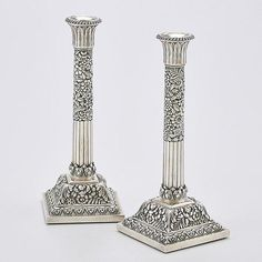 Set of four Tiffany  Co. Sterling Silver repousse candlesticks