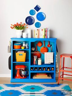 Every+last+inch+of+this+one-time+entertainment+center+is+packed+with+smart+kitchen+storage.+Removing+the+door+creates+easy-access+open+storage.+Pegboard+turns+the+open+back+of+the+TV+shelf+into+hanging+storage.+Four-inch+PVC+pipe+cut+to+length+and+painted+was+adhered+to+the+former+VCR+shelf+with+construction+adhesive+for+wine+storage.+Oh,+and+did+we+mention+that+new+fabulous+paint+job?