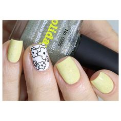 Pastel yellow nails with floral stamping #nailart #manicure #nails #naildesign #manicureideas #pastelnails #floralstamping #nailstamping