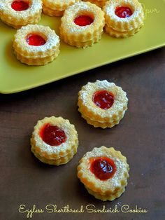 Eggless Shortbread Sandwich Cookies~~These shortbread cookies are amazing. I baked a super buttery shortbread cookies which sandwiched them later with some strawberry jam. These cookies looks exactly like the famous Linzer cookie eventhough linzer cookies have nuts and cinnamon in it.