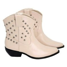 Off white studded cowboy boots 8 These sassy off-white cowboy boots have a low stance and stud work. They are new in box and made by wicked Wednesday. They are a size 8. Stud work in silver tone. These exhibit extremely minor shelf wear Barely noticeable. Man made materials. Wicked Wednesday Shoes Ankle Boots & Booties
