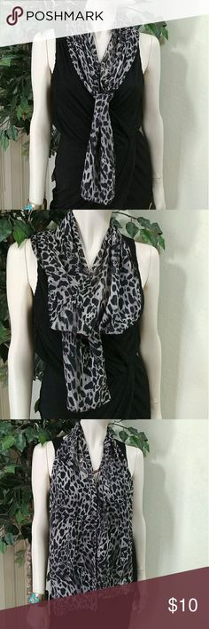 """Leopard print soft scarf Leopard Print Scarf, color grey/black/white blend, sorry no tag to identify the brand! This is a great addition that will add spice to your wardrobe. Made out of 100% Polyester, soft and light, ideal for light and breezy weather, size is 10"""" width x 56"""" length,?comes new without tag as closeout merchandise in good cosmetic condition. Accessories Scarves & Wraps"""