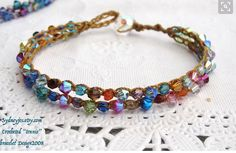 Spring rainbow bracelet is made with Swarovski and Czech crystals crocheted on tan/gold colored cord, its a double dainty bracelet with the most of beautiful sparkly rainbow colors. ( The symbol of a rainbow is a promise from God) its approx 7.5 but can be made any size...    Copyright 2008 tennis bracelet by Sydneyjo... original crocheted jewelry since 2008