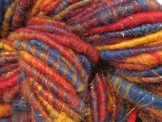 Primary Sparkle handspun sparkly corespun art yarn 62 yds by SpinningWheelStudio on @Etsy