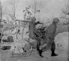 13th Infantry men, gather materials to make their snow-covered dugout in the Hurtgen Forest in Germany more comfortable. (Small).jpg