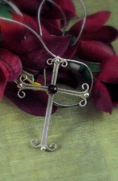 This is a beginner level weaving project that creates a beautiful cross pendant. 40 photos with step by step instructions.    Materials:   • One 6mm