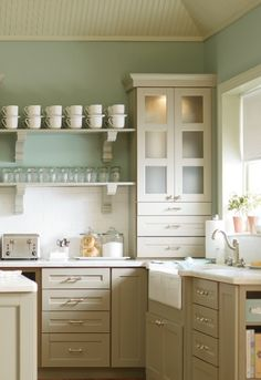 Martha Stewart Kitchen cabinetry in Ox Hill. Flat center panels & double batten doors gray kitchen cabinets, blue walls paint color, gray shelves with gray corbels, farmhouse sink, beadboard ceiling, subway tiles backsplash and marble counter tops.