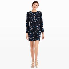 """A pretty dress with all-over intricately embroidered flowers, the Kasienna adds a subtle dose of whimsy to a timeless silhouette. Polyester Straight fit 36"""" in length, based on a size 6 Round neck; all-over embroidered flower and vine pattern; long sleeves; hidden back zip with hook-and-eye closure Dry clean Imported"""