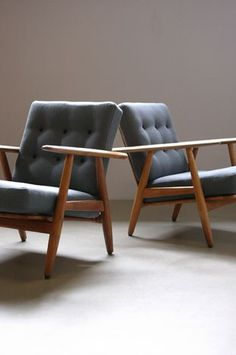 Hans Wegner Cigar Chairs Beautiful pair of Cigar chairs in solid oak designed by Hans Wegner for Getama, Denmark. Original sprung cushions fully reconditioned with fantastic new upholstery. 69W x 76D x 74H