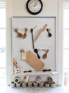 Measuring cups, wooden spoons, and cutting boards dot a wall at Knead.