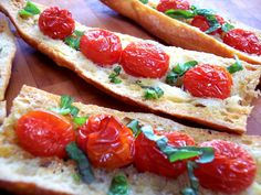 Tomato Bread - Take a good quality baguette, and scoop out a well down the middle, stick in some grape tomatoes, drizzle with olive oil, and a sprinkling of salt and pepper, place on a baking sheet and bake in a 350 degree oven till tomatoes are soft around 30 min.